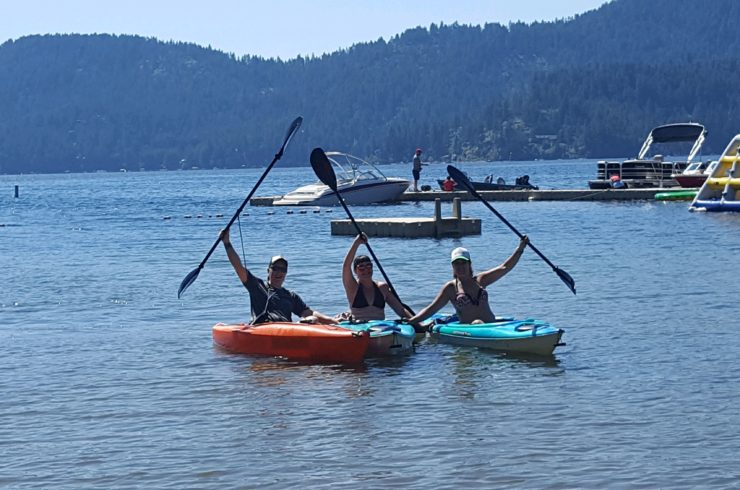 Designer Decal employees in kayaks